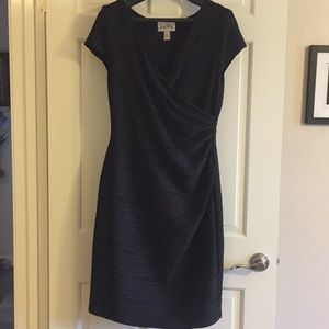 Stretchy little black dress with cap sleeves.